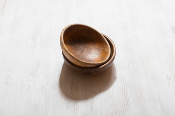 wooden bowls on white table