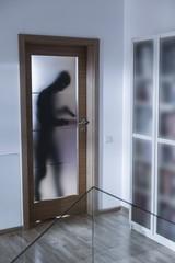 Armed burglar breaking into house