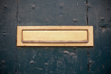 Dark green door with letter slot mailbox