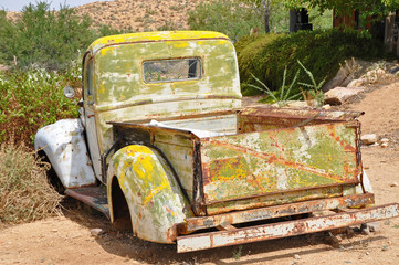 Abandoned old car on route 66 road in USA