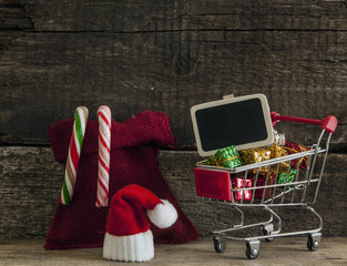 Christmas holiday background with Santa hat and decorations.