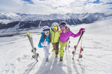 Happy youth in colorful jackets ski alps resort