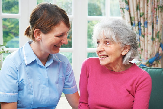 Senior Woman Chatting With Carer