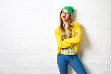 Street Style Hipster Girl at White Brick Wall Background