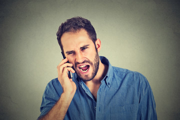 angry man, mad worker, pissed off employee shouting while on phone