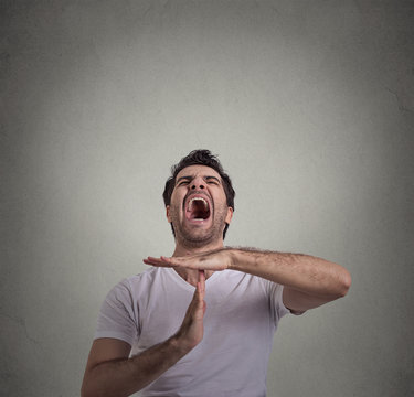 man showing time out hand gesture, frustrated screaming to stop