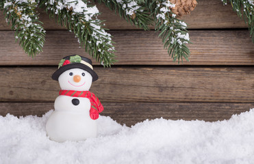 Holiday Snowman Figurine With a Rustic Wooden Background