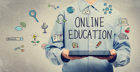 Online Education concept with young man holding a tablet