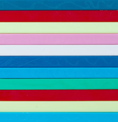 Colorful striped background. Plastique sticks of different color