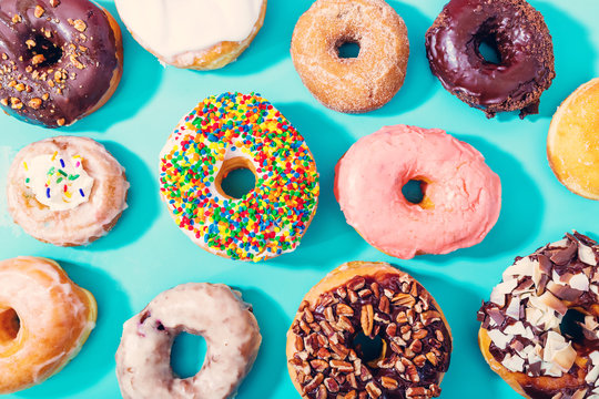 Assorted donuts on pastel blue background