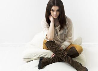 Pretty girl portrait sitting on cushions