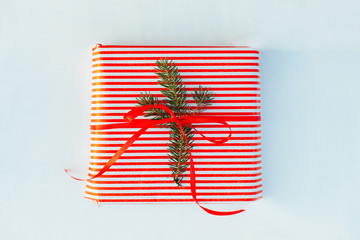Gift wrapped with a red bow