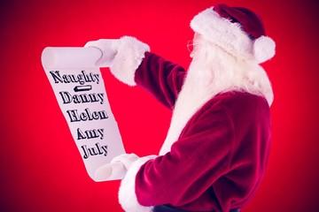 Composite image of santa claus reads a list
