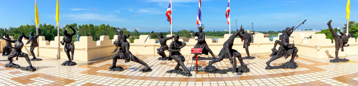 Statues of Chinese Shaolin monks depicting different martial arts poses