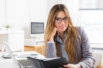 Young attractive woman working at the office