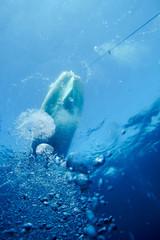 Bubbles under boat, Mediaterranean sea.