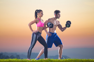 man and woman outdoor biceps exercise