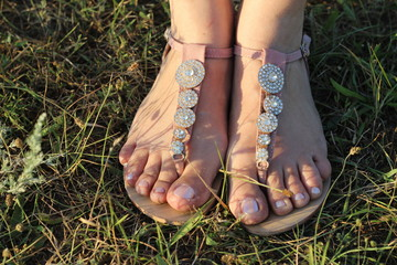 Feet girl in sandals