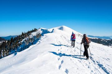 Girls go on snowy mountain peak