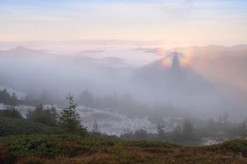 Autumn landscape with beautiful phenomenon in fog