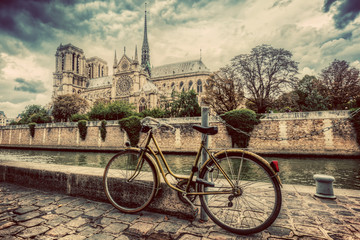 Printed kitchen splashbacks Bestsellers Retro bike next to Notre Dame Cathedral in Paris, France. Vintage