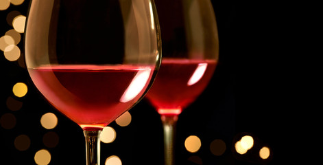 Two glasse of red wine with illumination bokeh background. Isolated on white with copy space.