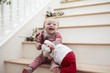 Young Girl On Stairs In Pajamas With Toy At Christmas
