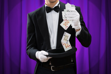 Wall Mural - Midsection Of Magician Performing Trick With Cards And Hat