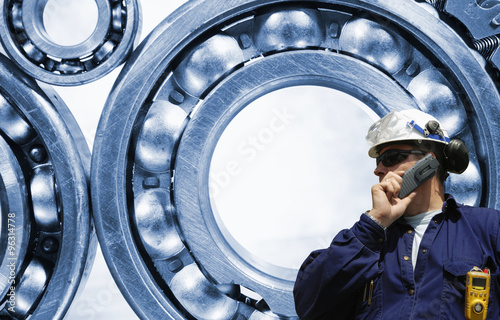 Wall mural industry worker, engineer with giant ball-bearings in background