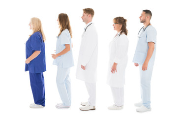 Side View Of Medical Professionals Standing In Row