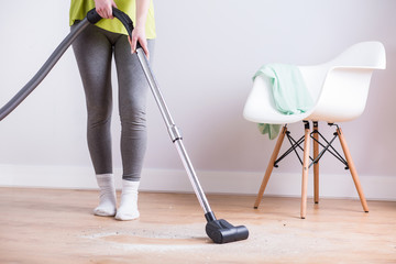 Maid vacuuming floor