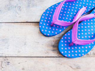 Blue flip flop with pink heart pattern