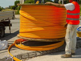 Industrial cable drums of fiber optic cables from underground in a micro trench