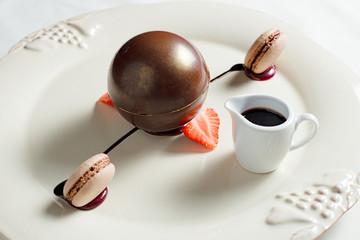 Scope of dark chocolate filled with hazelnut biscuit