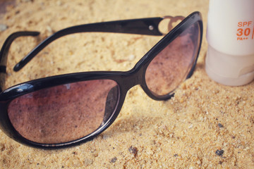 Sun glasses with sunscreen on the beach