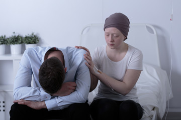 Girl with cancer consoling dad