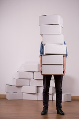 Man holding many cardboard boxes