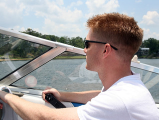 Young Man Driving a Speedboat