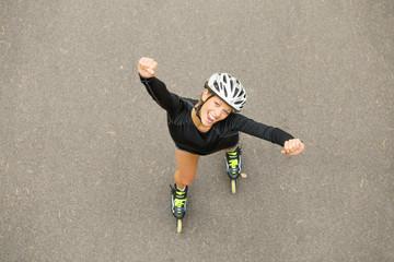 Happy woman on rollerskating