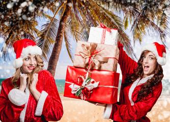 Buitiful girls dressed like Santa Claus
