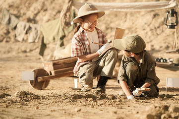 Children conduct archeological excavations
