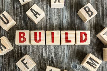 Wooden Blocks with the text: Build
