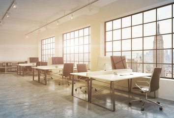 Workplaces in a sunset loft open space office. Tables are equipped with computers; book shelves. New York panoramic view. A concept of a high quality consulting services. Toned image. 3D rendering.