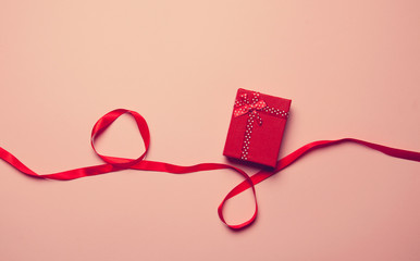Gift box and red ribbon