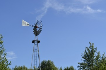 Windmill device for renewable energy on a small family farm