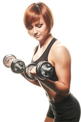 Young female athlete doing dumbbell curls