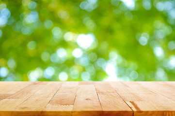 Wood table top on green natural bokeh abstract background