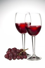 red wine in a wine glass with grapes