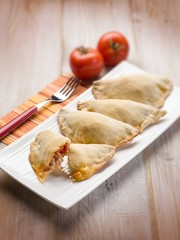 panzerotti with tomato and mozzarella selective focus