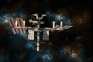 The International Space Station with the space shuttle docked on against a background of stars.
